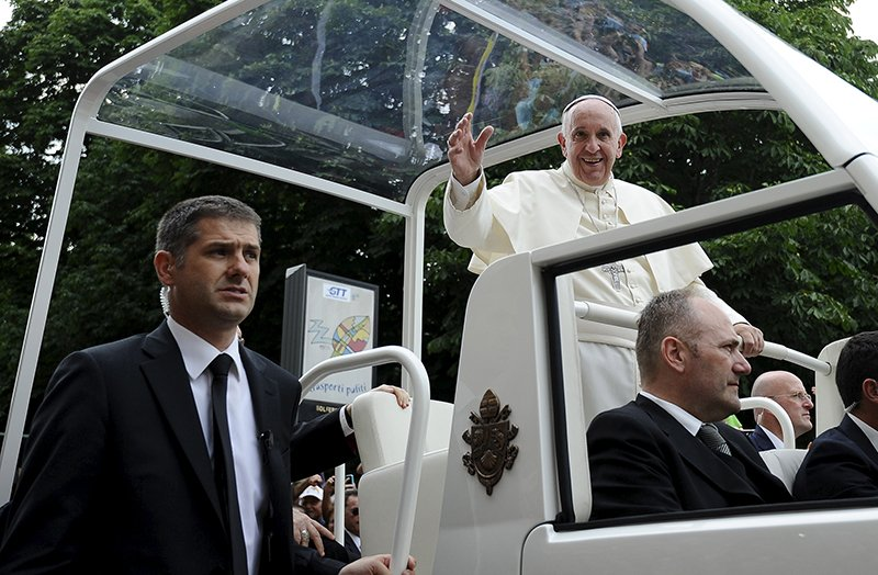 Pope Francis waves as he leaves at the end of his two-day pastoral visit in Turin, Italy, on June 22, 2015.  Photo courtesy of REUTERS/Giorgio Perottino *Editors: This photo may only be republished with RNS-POPE-USTRIP, originally transmitted on June 30, 2015.