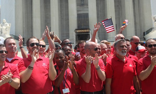 (RNS16-jun26) Members of the Gay Men's Chorus of Washington, DC, celebrate after the Supreme Court announced its rulings in cases related to same-sex marriage Wednesday (June 26). RNS photo by Adelle M. Banks.