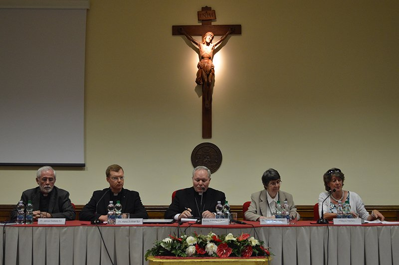 Left to right; James Corkey, theology professor at the Pontifical Gregorian University; Hans Zollner, president of the Pontifical Gregorian University's Centre for Child Protection; Edward J. Burns, chairman of the US Conference of Catholic Bishops' committee on child protection; Sarah Butler, president of the US Academy of Catholic Theology; Philippa Hitchen, journalist at Vatican Radio; speak to the press during a conference on how to handle the current clergy sex abuse crisis. Religion News Service photo by Rosie Scammell