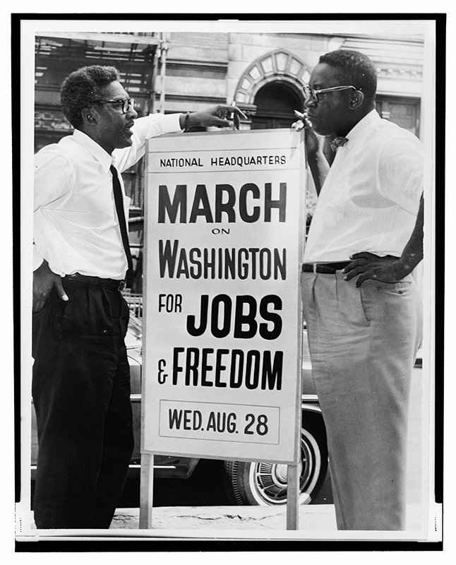 Bayard Rustin speaks with Cleveland Robinson at 170 W 130 St., during the March on Washington. Photo courtesy of Library of Congress (Public Domain)
