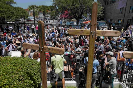 Mourners gather outside Morris Brown AME Church for a vigil the day after a mass shooting in Charleston, South Carolina on June 18, 2015. A 21-year-old white gunman accused of killing nine people at a historic African-American church in Charleston, South Carolina, was arrested on Thursday, said U.S. officials, who are investigating the attack as a hate crime. Photo courtesy of REUTERS/Brian Snyder *Editors: This photo may only be republished with RNS-JUNETEENTH-CHARLESTON, originally transmitted on June 19, 2015.