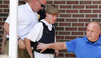 Police lead suspected shooter Dylann Roof, 21, into the courthouse in Shelby, North Carolina, on June 18, 2015. Roof, a 21-year-old with a criminal record, is accused of killing nine people at a Bible-study meeting in a historic African-American church in Charleston, South Carolina, in an attack U.S. officials are investigating as a hate crime. REUTERS/Jason Miczek *Editors: This photo may only be republished with RNS-WAX-COMMENTARY, originally transmitted on June 19, 2015.