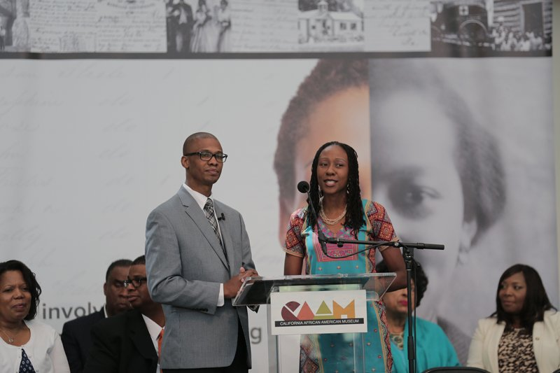 """Jermaine Sullivan and his wife, Kembe, both featured in the movie """"Meet the Mormons,"""" conduct a media event in Los Angeles to announce the Freedmen's Bureau Project, on June 19, 2015. Photo courtesy of the Church of Jesus Christ of Latter-day Saints."""