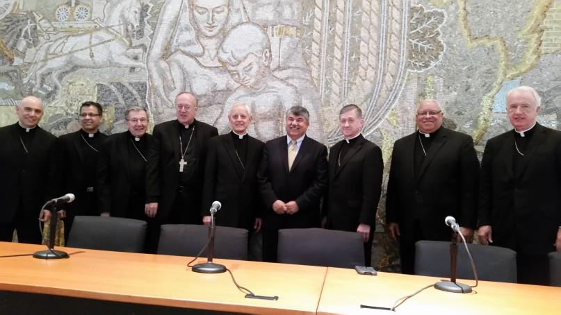 AFL-CIO President Richard Trumka flanked by eight Catholic bishops. Religion News Service photo by Mark Silk