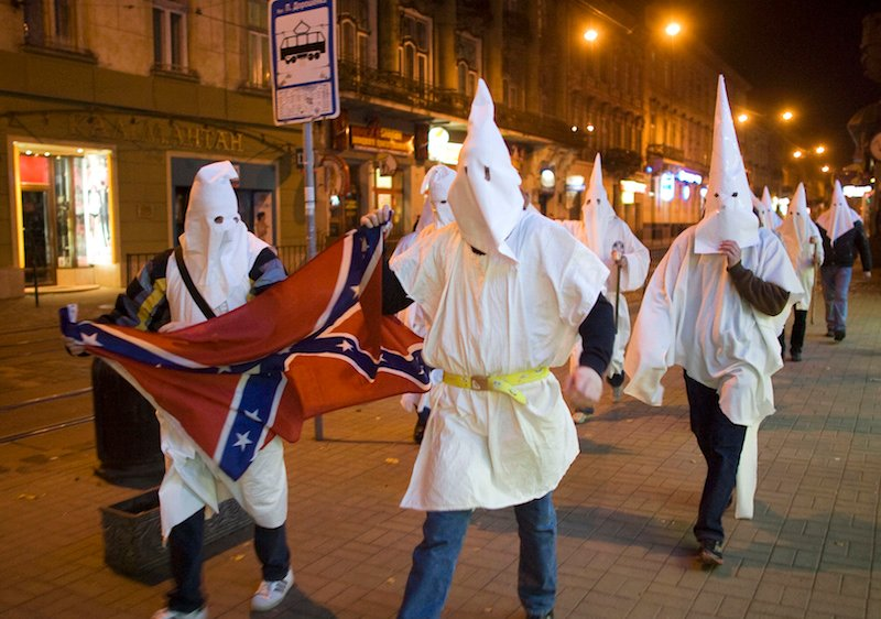 Supporters dressed as members of the Ku Klux Klan, using the occasion of Halloween to mask their faces from the police.