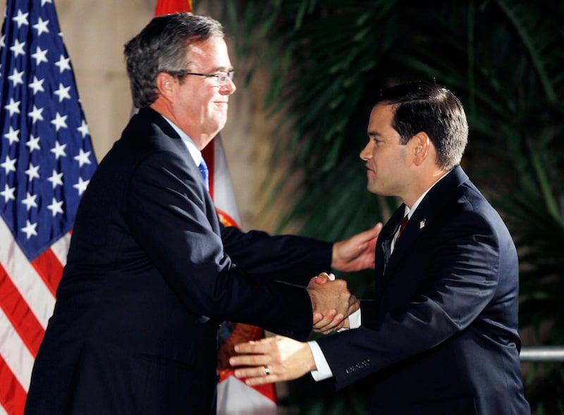 U.S. Republican presidential candidates Marco Rubio (R) shakes hands former Florida Governor Jeb Bush ain a Nov. 2, 2010 photo. Photo courtesy REUTERS/Hans Deryk.