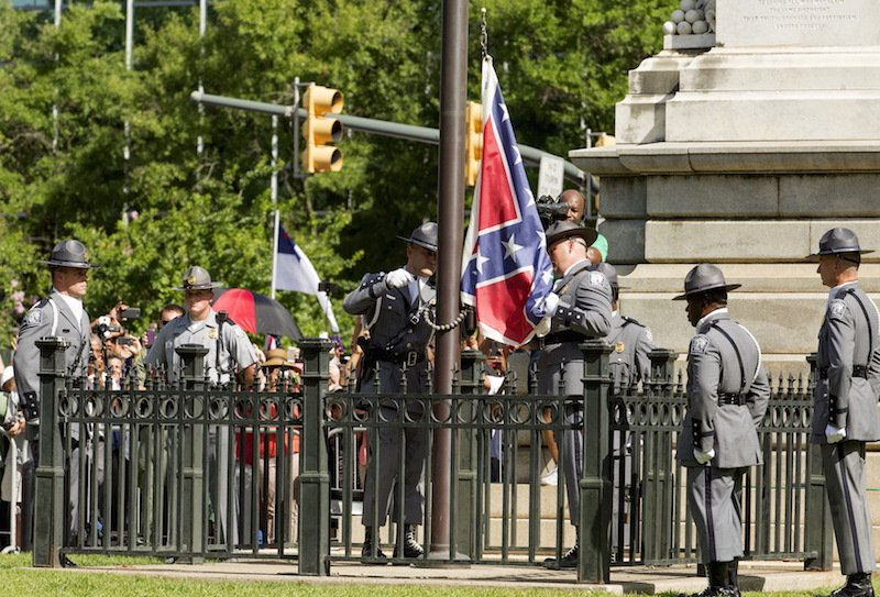The Confederate battle flag is permanently removed from the South Carolina statehouse grounds during a ceremony in Columbia, South Carolina, July, 10, 2015.  Courtesy of REUTERS/Jason Miczek *Editors: This photo may only be republished with RNS-CHARLESTON-ANNIVERSARY, originally transmitted on June 8, 2016.