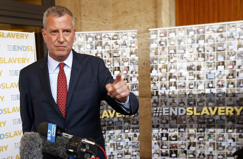 """New York City Mayor Bill de Blasio gestures as he holds a news conference during the """"Modern Slavery and Climate Change"""" conference at the Vatican July 21."""