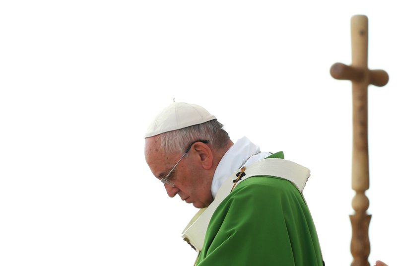 Pope Francis prays as he leads a mass in Asuncion, Paraguay, on July 12, 2015. Photo courtesy of REUTERS/Alessandro Bianchi