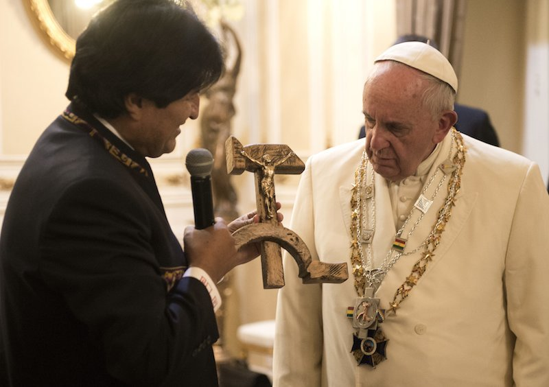 Pope Francis receives a gift from Bolivian President Evo Morales -- a crucifix on a hammer and sickle --  in La Paz, Bolivia. Photo courtesy of REUTERS/Osservatore Romano