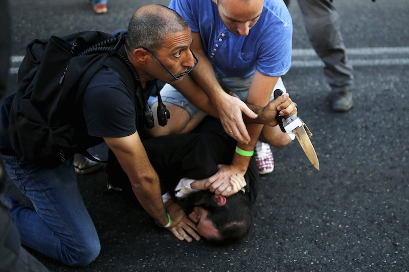 People disarm an Orthodox Jewish assailant after he stabbed and injured six participants at an annual gay pride parade in Jerusalem on Thursday, police and witnesses said.Photo by Amir Cohen courtesy of Reuters
