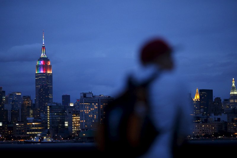 A man watches the skyline of Manhattan as the Empire State Building is lit in rainbow colors during the celebration of the annual Gay Pride Parade in New York on June 28, 2015. Photo courtesy of REUTERS/Eduardo Munoz *Editors: This photo may only be republished with RNS-LUPFER-COLUMN, originally transmitted on July 1, 2015.