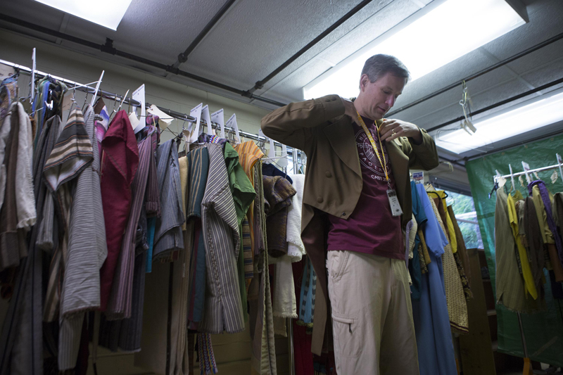 Christian Hancey of Pittsford tries on his coat in the costume room for the Hill Cumorah Pageant on July 9, 2015. He has been cast to portray Joseph Smith, the founder of Mormonism. Photo by Lauren Petracca, courtesy of USA Today