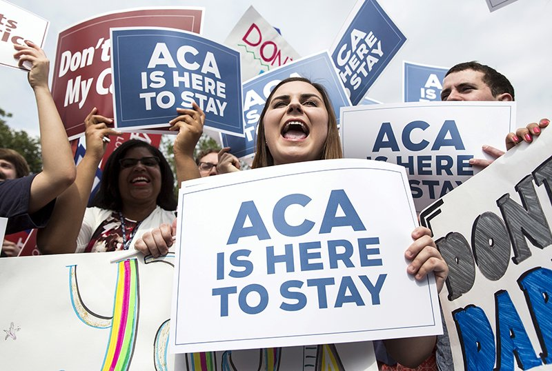 Supporters of the Affordable Care Act celebrate after the Supreme Court up held the law in the 6-3 vote at the Supreme Court in Washington on June 25, 2015. Photo courtesy of REUTERS/Joshua Roberts *Editors: This photo may only be republished with RNS-NUNS-CONTRACEPTION, originally transmitted on July 14, 2015 or with RNS-HOLLMAN-COLUMN, originally transmitted on March 21, 2016.