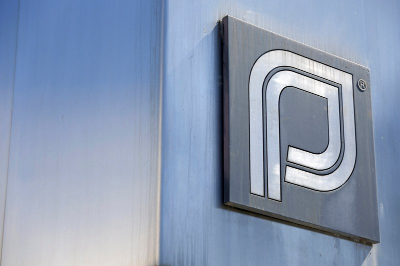 The Planned Parenthood logo is pictured outside a clinic in Boston. The organization's leader defended it before Congress on Sept. 29, 2015. Photo courtesy of Reuters.