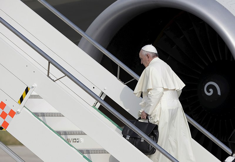 Pope Francis boards a plane for his pastoral trip, at Fiumicino airport in Rome, Italy, on July 5, 2015. Photo courtesy of REUTERS/Max Rossi  *Editors: This photo may only be republished with RNS-POPE-CARBON, originally transmitted on July 9, 2015.