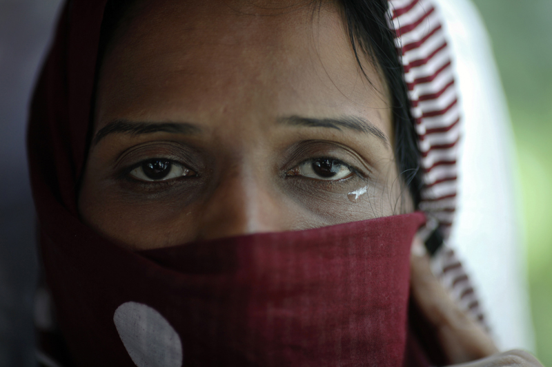 A Pakistani refugee, a member of the Ahmadiyya, an Islamic minority sect, cries as she leaves a detention center with her family on a bus in Bangkok on June 6, 2011. The Ahmadiyya community in Pakistan is often targeted in attacks by Islamic extremists. Photo courtesy of REUTERS/Damir Sagolj *Editors: This photo may only be republished with RNS-RELIGIOUS-FREEDOM, originally transmitted on May 3, 2016.