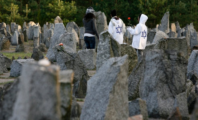 Israeli youths stand amongst stones at the Treblinka Nazi Death Camp memorial, eastern Poland, on April 14, 2008.  Photo courtesy of REUTERS/Kacper Pempel