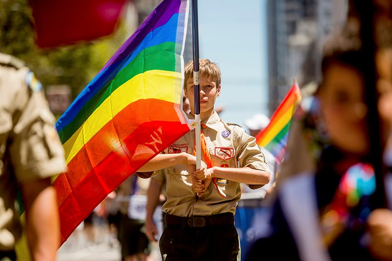 Boy Scout Casey Chambers carries a rainbow flag during the San Francisco Gay Pride Festival in California on June 29, 2014. Photo courtesy of REUTERS/Noah Berger *Editors: This photo may only be republished with RNS-SCOUTS-REACTION, originally transmitted on July 14, 2015.
