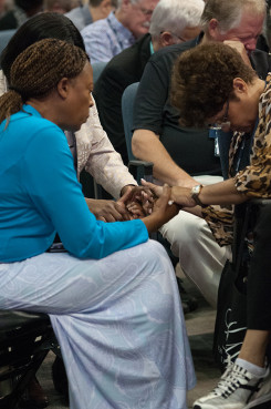 Delegates ask for God's blessing on the proceddings 60th General Conference Session of the Seventh-day Adventist Church, in San Antonio, Texas. Photo courtesy of Bryant Taylor/NAD