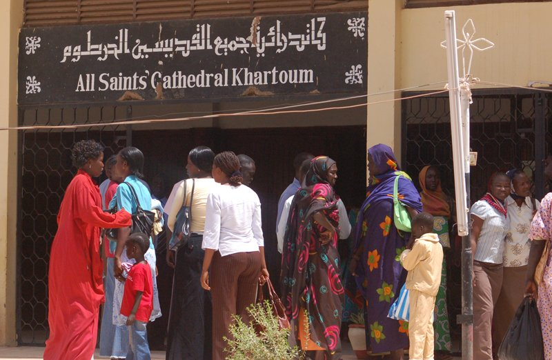 Sudanese women, some dressed in trousers, are seen outside the All Saints Cathedral in Khartoum. In the Nuba Mountains, women dressed in trousers have been arrested for indecent dressing. Religion News Service photo by Fredrick Nzwili
