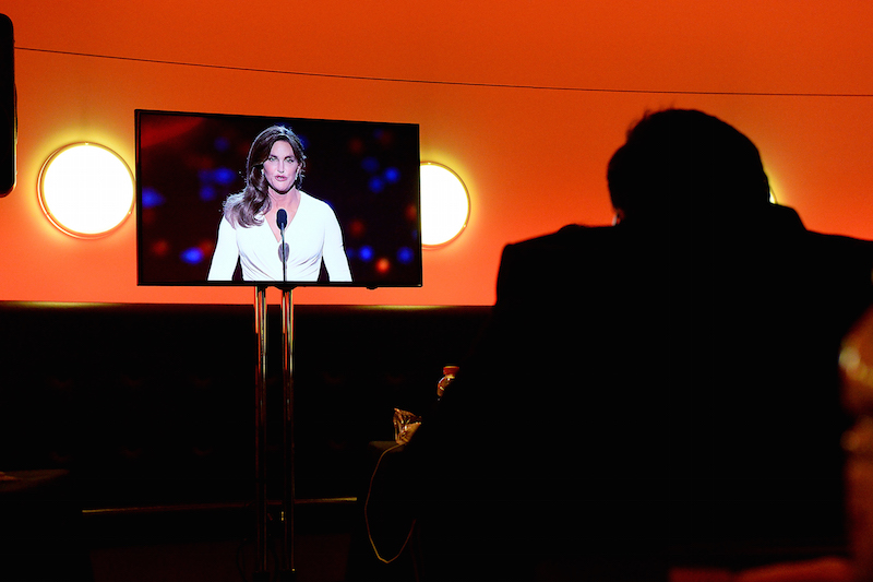 caitlyn jenner is seen on a tv set in the press room during the 2015