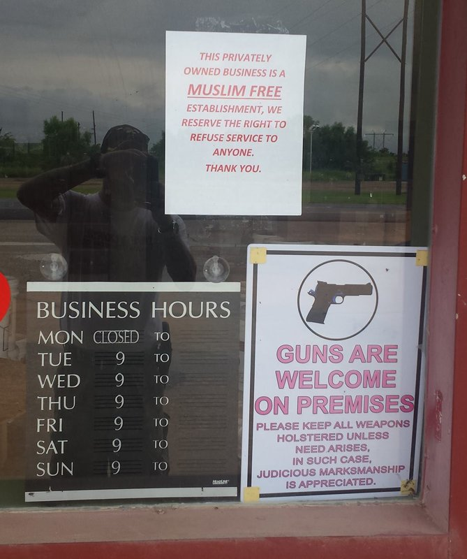 """A survival gear store in Oktaha, Okla., has put a sign on the door that reads, """"This privately owned business is a Muslim free establishment..."""" Photo courtesy of CAIR"""