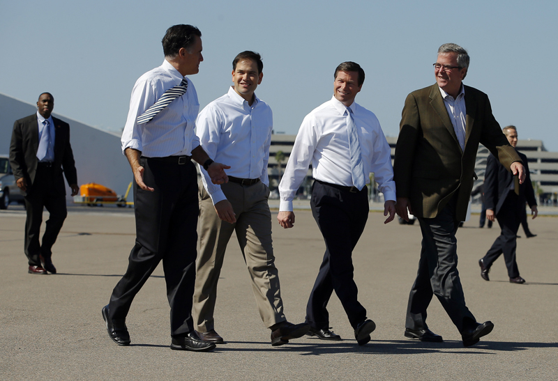 Republican presidential nominee Mitt Romney walks to his campaign plane with U.S. Senator Marco Rubio (R-FL), second left, U.S. Representative Connie Mack (R-FL), second right, and former Florida Governor Jeb Bush (R), far right, after a campaign rally in Tampa, Florida on October 31, 2012. Photo courtesy of REUTERS/Brian Snyder *Editors: This photo may only be republished with RNS-BAPTISTS-POLITICS, originally transmitted on August 3, 2015.