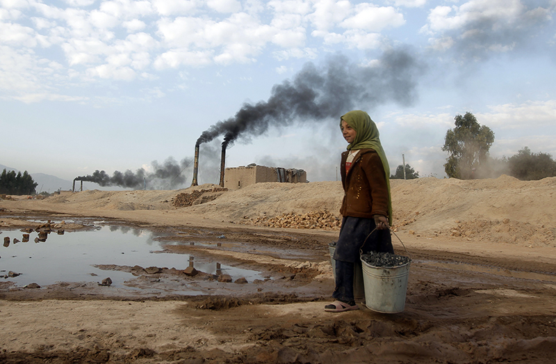 Aisha, 11, carries coal to be used for cooking and heating from a brick-making factory in Jalalabad, Afghanistan on December 17, 2013. Photo courtesy of REUTERS/Parwiz *Editors: This photo may only be republished with RNS-CLIMATE-MUSLIMS, originally transmitted on August 18, 2015.