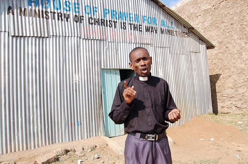 Rev. James Kyalo, head of the House of Prayer for All, a Pentecostal church in Kyumbi area, says the brews keep young men away from churches. Religion News Service photo by Fredrick Nzwili