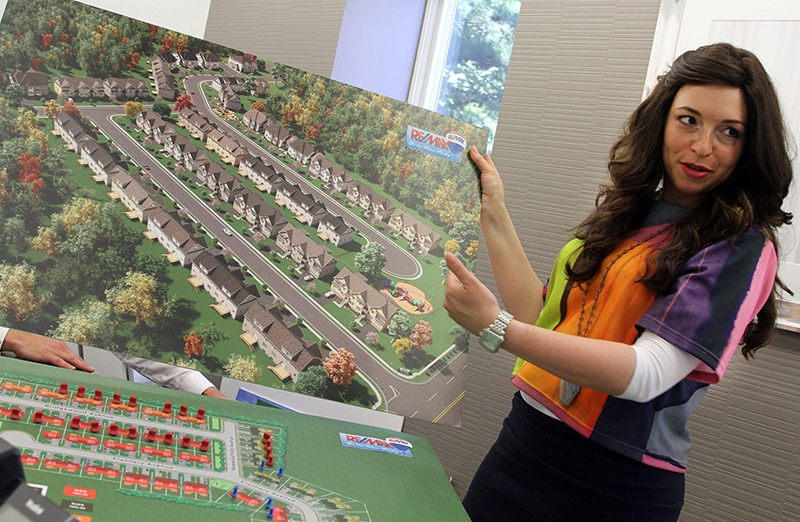 Re/Max realtor Esther Klein talks about the plans for Cedar Wood Hills, currently under construction at Cedar Bridge and New Hampshire Avenues in Lakewood, on Monday, July 20, 2015. Photo courtesy of USA Today
