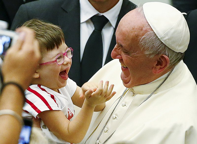 Pope Francis laughs with a baby during a special audience with parish cells for the evangelization in Paul VI hall at the Vatican on September 5, 2015. Photo courtesy of REUTERS/Tony Gentile *Editors: This photo may only be republished with RNS-POPE-QUOTES, originally transmitted on Sept. 15, 2015.