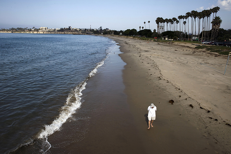 A man walks along the Pacific Ocean at Goleta Beach Park in Goleta, California on July 30, 2015. Photo courtesy of REUTERS/Patrick T. Fallon *Editors: This photo may only be republished with RNS-SCENERY-RELIGION, originally transmitted on August 6, 2015.
