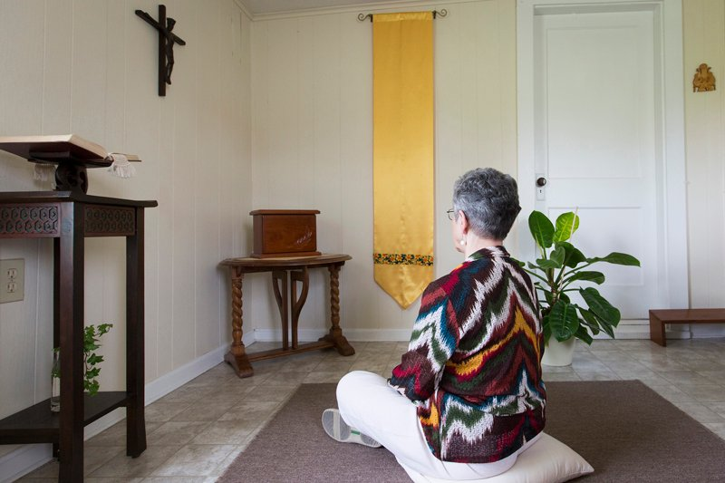 Sister Monica sits in front of her tabernacle in her home. She has spent her career ministering to transgendered people. Religion News Service photo by Philip Scott Andrews