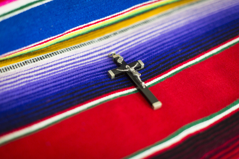 A crucifix rests on Sister Monica's bed in her home. She has spent her career ministering to transgendered people. Religion News Service photo by Philip Scott Andrews