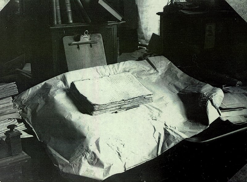 The printer's manuscript of the Book of Mormon rests on a table in this early 20th-century photograph. Photo courtesy of the Church of Jesus Christ of Latter-day Saints