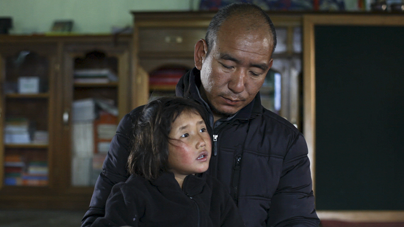 "Buddhist Monk Lobsang with 5-year-old Tashi in the documentary ""Tashi and the Monk,"" directed by Andrew Hinton. Photo courtesy of Tashi and the Monk"