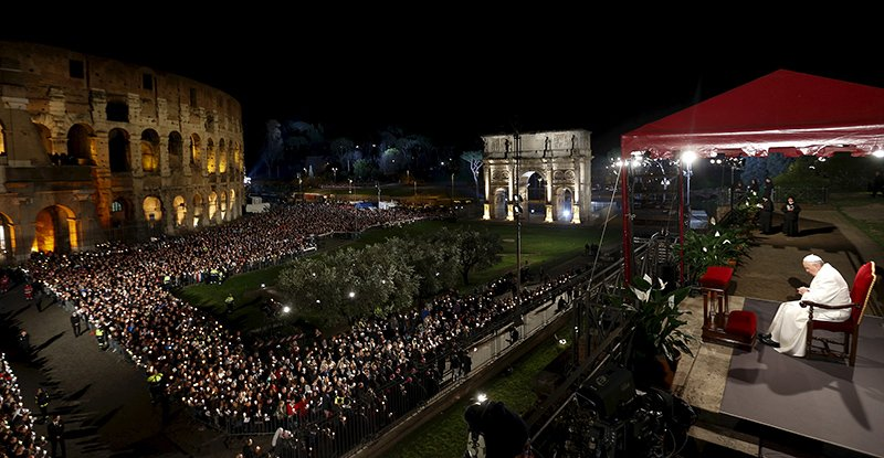 "Pope Francis leads the ""Via Crucis"" (Way of the Cross) procession, which commemorates the crucifixion of Jesus Christ, at the Colosseum in Rome on April 3, 2015. Photo courtesy of REUTERS/Alessandro Bianchi *Editors: This photo may only be republished with RNS-VATICAN-LUTHER, originally transmitted on August 26, 2015."