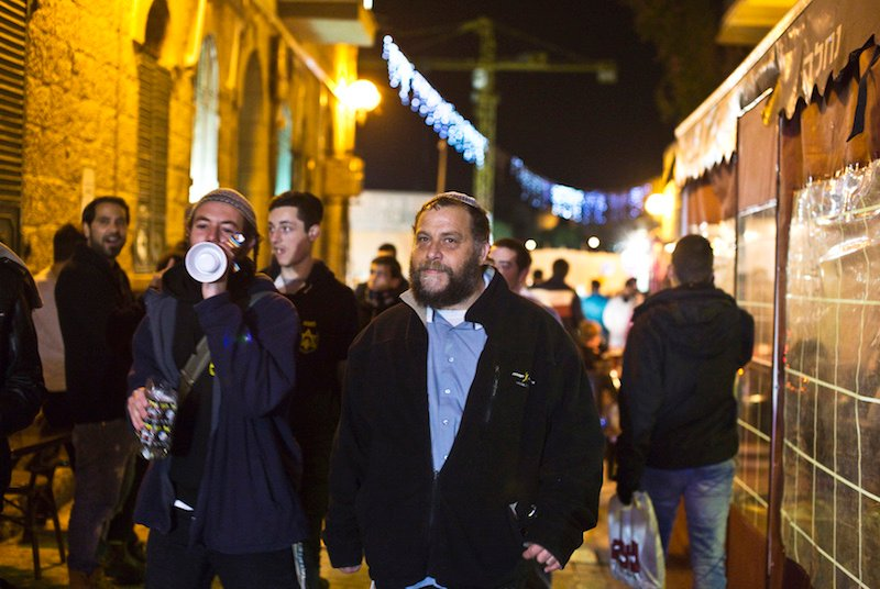 "Benzion Gopstein (C), sometimes spelled ""Gopshtein, ""leader of the far-right Israeli group Lehava, gathers with fellow activists in Jerusalem December 25, 2014.  Photo courtesy REUTERS/Nir Elias"