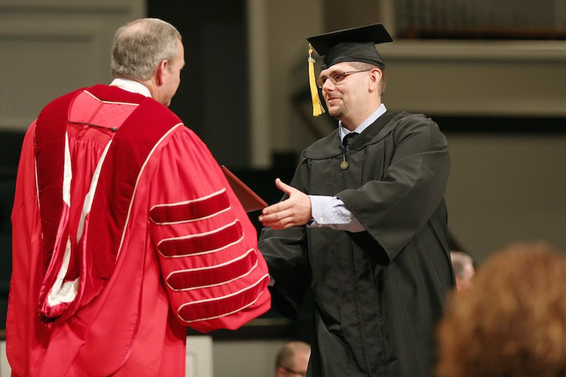 Adam Smallwood, graduate, accepts his diploma at summer graduation at Union University, July 25, 2015. Photo courtesy Kristi McMurry Woody