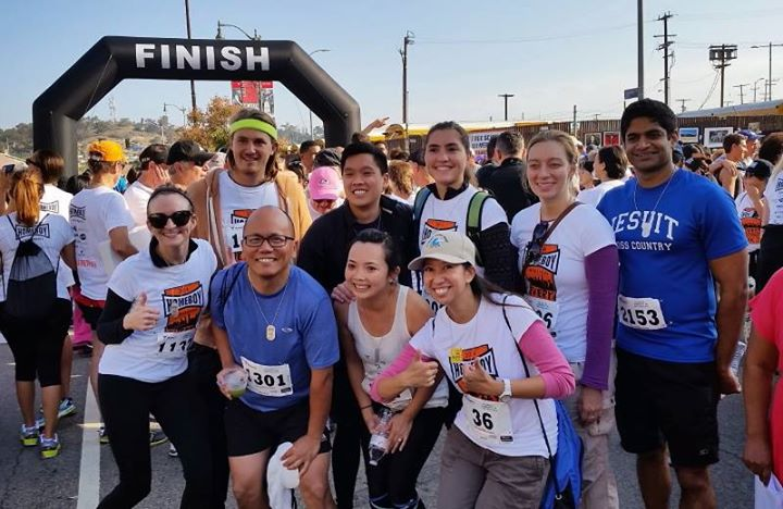 Regina Bunye, front row with pink sleeves, with a group of Ignatian Young Adults after a 5k for Homeboy Industries, the Jesuit's ministry with former gang members. Photo courtesy of Blessed Sacrament Parish's Ignatian Young Adult's group