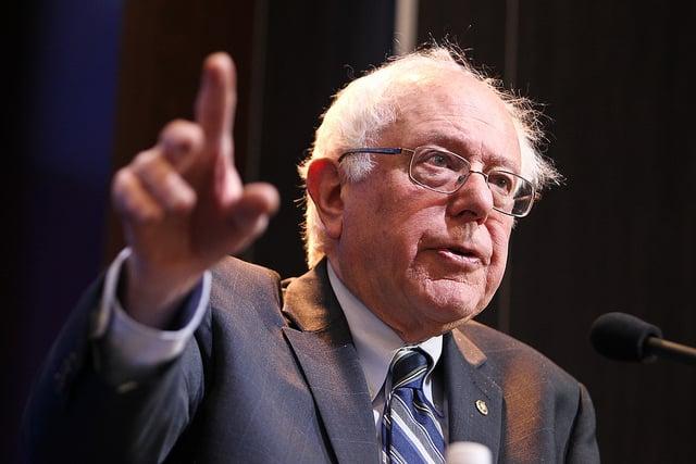 Bernie Sanders in 2015 addressing the Brookings Institution | Photo by Brookings Institution via Flickr (http://bit.ly/1OWOn4K)