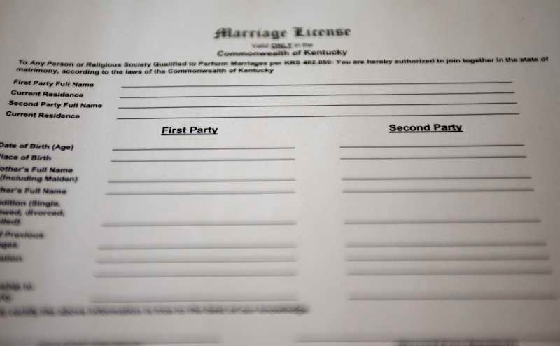 """A copy of a new Kentucky marriage certificate application for same-sex couples, with """"First Party"""" and """"Second Party."""" Rowan County Clerk's office issued a license Friday to a same-sex couple. REUTERS/Chris Helgren"""