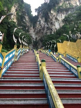 That's a lot of stairs. Some Hindus pray, with hands together, as they climb them.