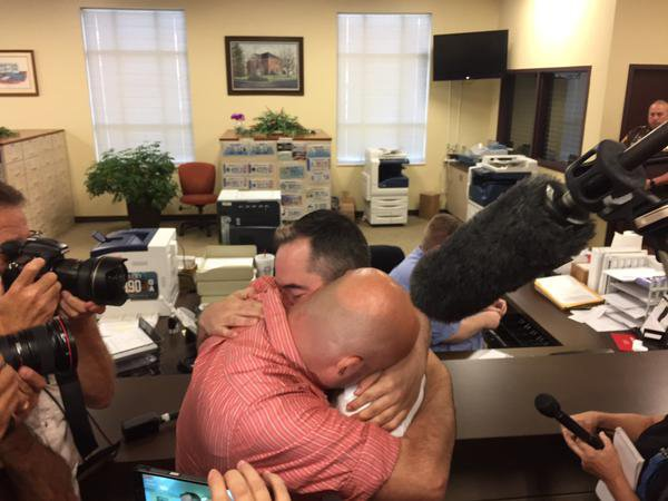William Smith and James Yates received a marriage license Friday, Sept. 4, 2015, from Rowan County (Ky.) Deputy Clerk Brian Mason. Photo: Mike Wynn, The (Louisville, Ky.) Courier-Journal
