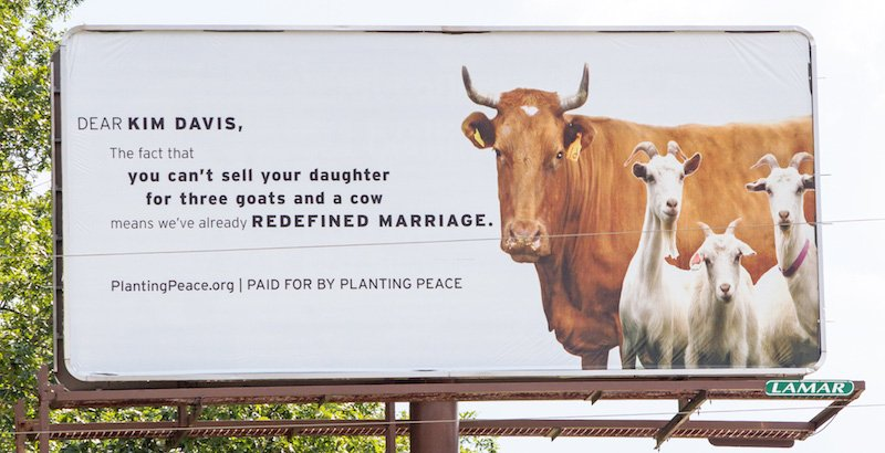 """Planting Peace erected a billboard in Davis' hometown of Morehead, Ky., that reads: """"Dear Kim Davis, The fact that you can't sell your daughter for three goats and a cow means we've already redefined marriage."""" Photo courtesy Planting Peace"""