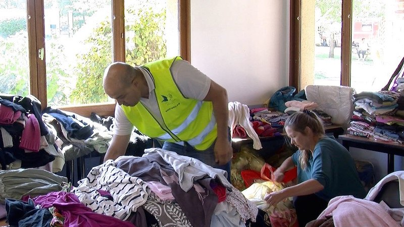 Volunteers sort clothing for Syrian and Iraqi refugees at a recreation center in Cergy Pontoise, a suburb outside of Paris. Photo courtesy Elizabeth Bryant