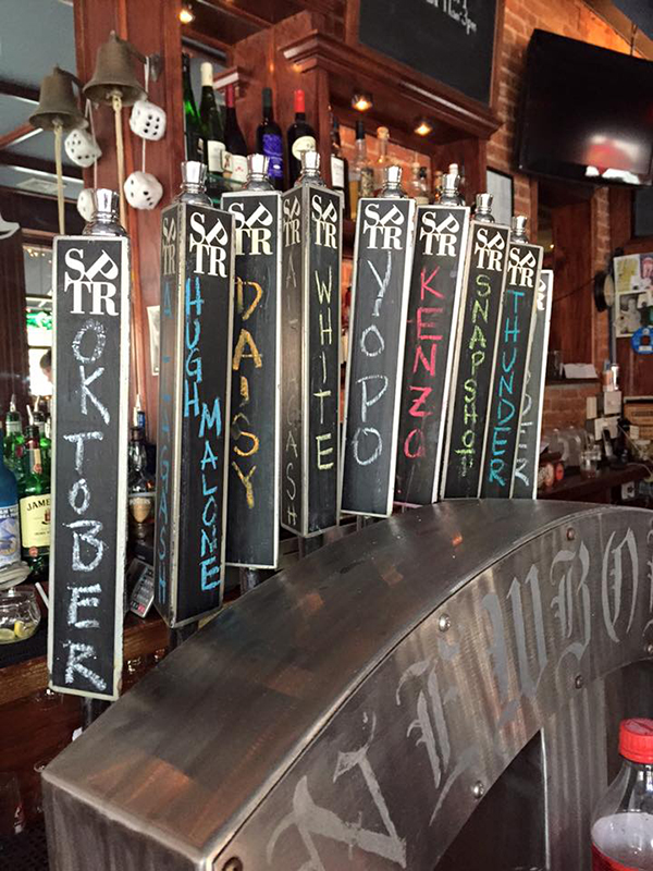 """Philadelphia Tap Room serves two pope inspired beers this weekend, """"Holy Wooder"""" and """"YOPO,"""" during Pope Francis' visit to the city on Sept. 26, 2015. Religion News Service photo by Anne Marie Hankins"""