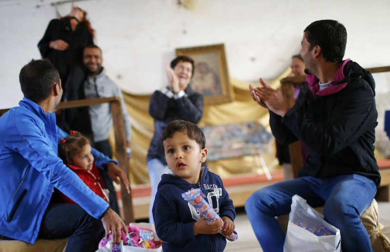 Refugees celebrate Eid al-Adha with Austrian villagers in the hall of Schloss Koenigshof, an ancient Habsburg castle in Bruckneudorf, Austria September 24, 2015. Photo courtest of Reuters/Leonhard Foeger