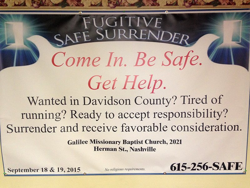 A sign in the Galilee Missionary Baptist Church fellowship hall, converted to a Fugitive Safe Surrender waiting area on Sept. 19, 2015. Religion News Service photo by Heidi Hall